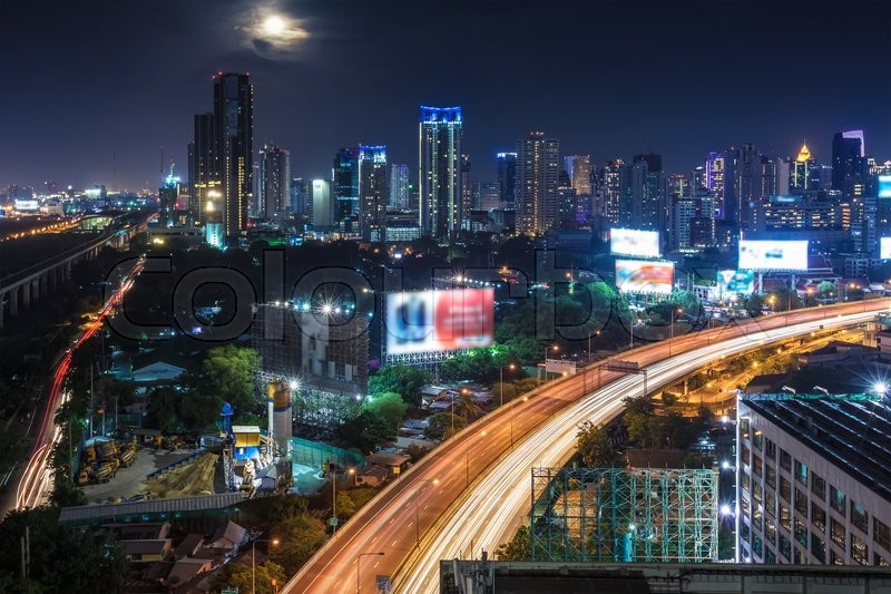 Business Building Bangkok city area at night life with transportation way and moon, logistic concept high angle bird eyes view, stock photo