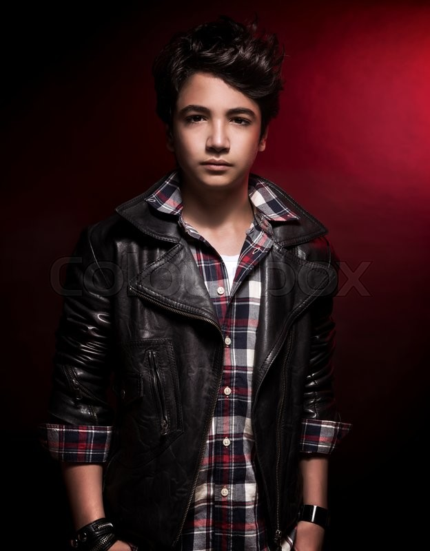 Stylish Teen Boy Portrait Over Dark Red Background