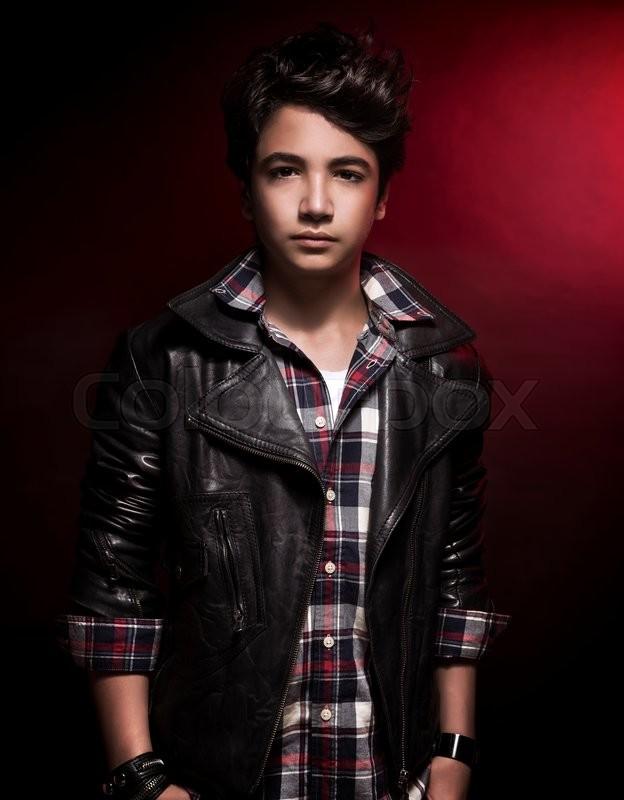 Stylish Teen Boy Portrait Over Dark Red Stock Photo Colourbox