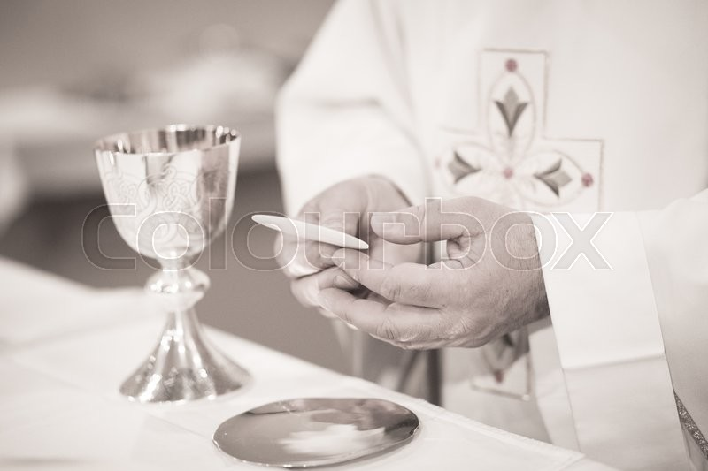 Black and white artistic digital photo of Catholic priest in church wedding marriage ceremony, stock photo