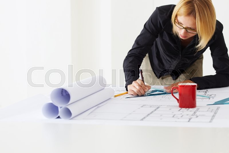 Portrait of female architect drawing line on blueprint copy space portrait of female architect drawing line on blueprint copy space stock photo colourbox malvernweather Image collections