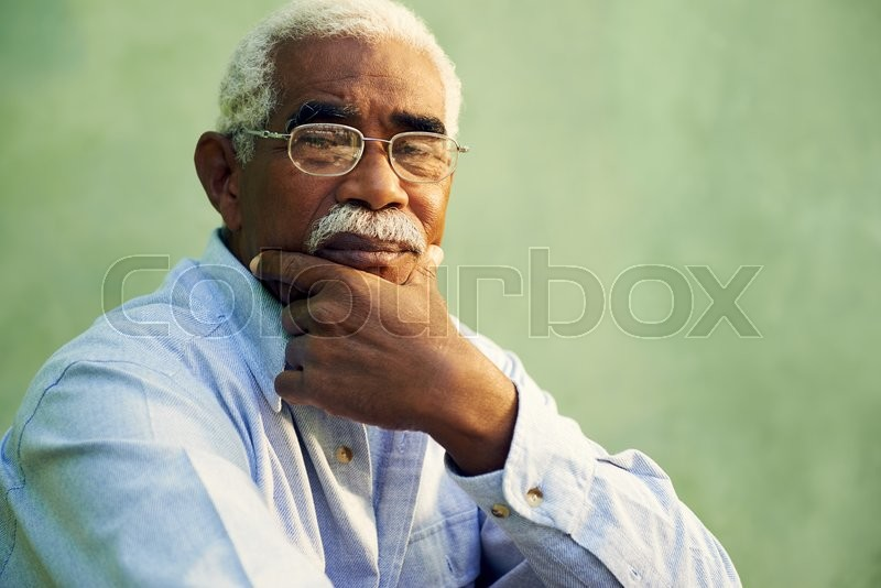 Black people and emotions, portrait of depressed senior man with glasses looking at camera. Copy space, stock photo