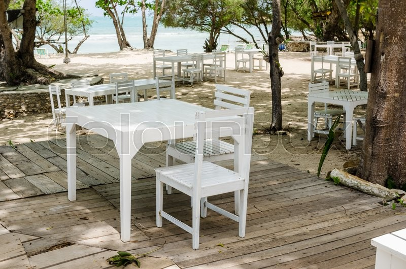 Wood dock White chair and table in Koh Samet Thailand, stock photo