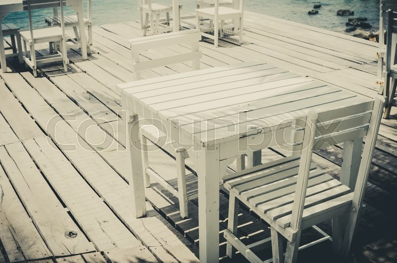 Wood dock White chair and table in Koh Samet Thailand vintage, stock photo