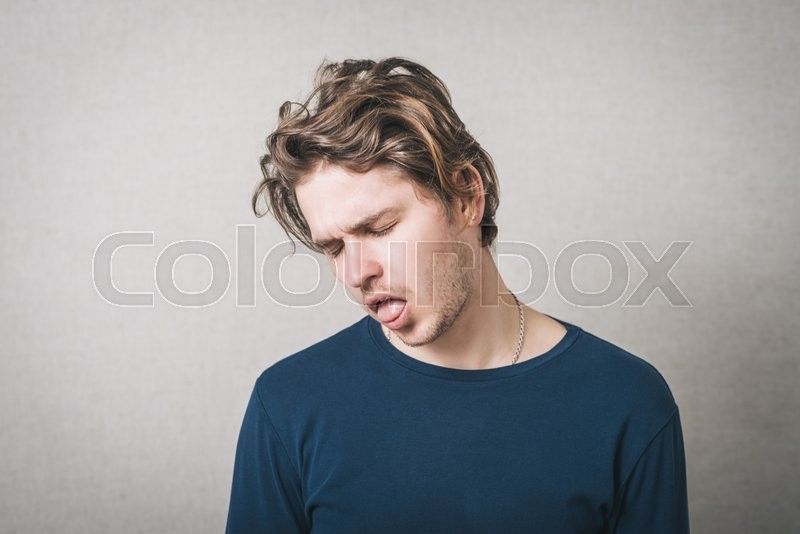 Why do guys stick their tongue out in pictures