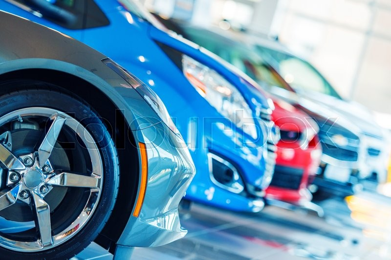 Stock image of 'Brand New Cars For Sale in Dealer Showroom. Car Business.'