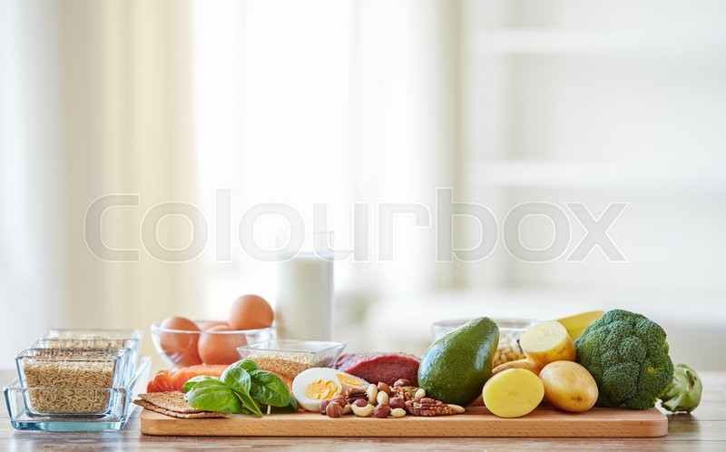 Balanced diet, cooking, culinary and food concept - close up of vegetables, fruits and meat on wooden table, stock photo