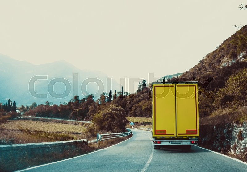 Truck on the road. Yellow cargo car, stock photo