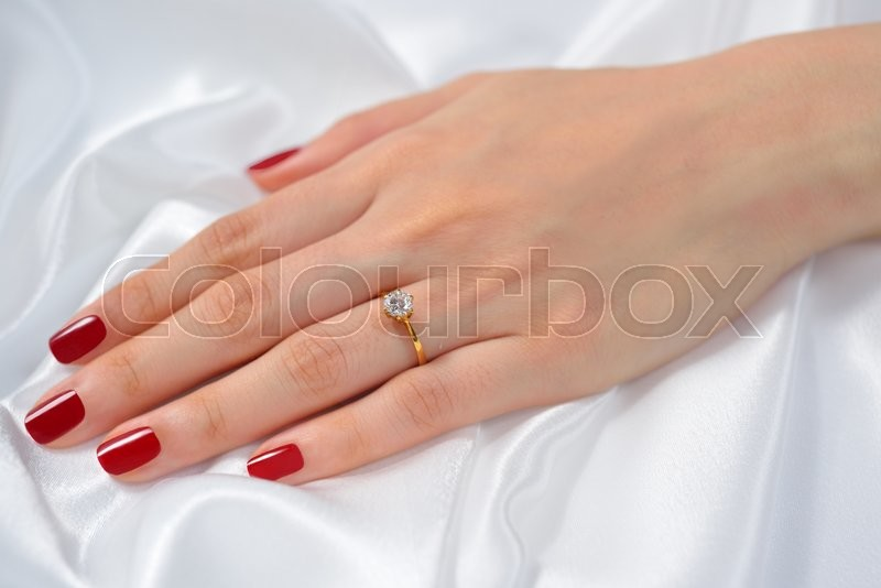 Wedding Ring On Hand Of Bride On White Cloth Stock Photo Colourbox
