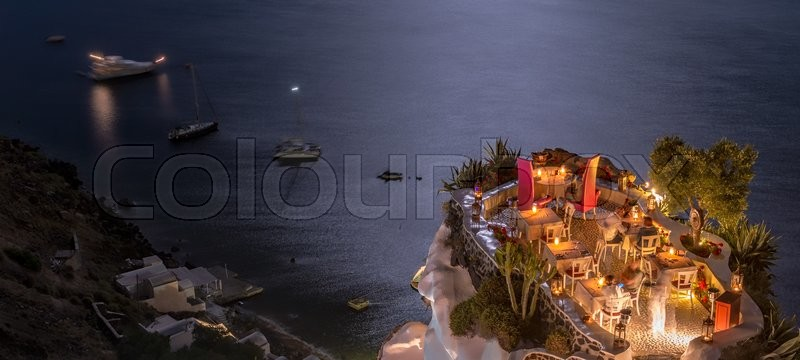 Terrace in front of the ocean. Restaurant with sea view at night, stock photo