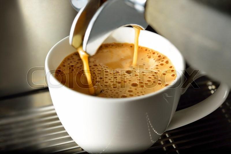 Coffee machine making espresso coffee in coffee shop, stock photo