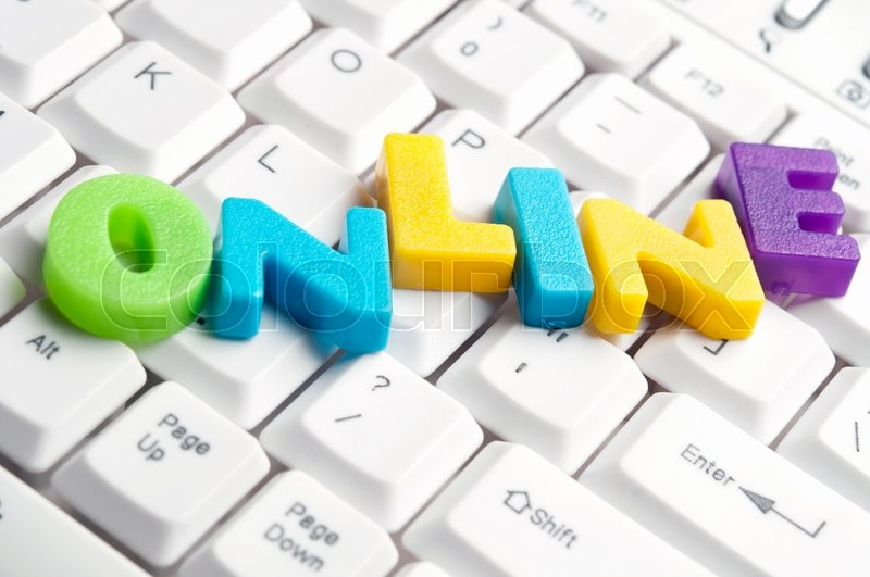 Online word made by colorful letters on keyboard, stock photo