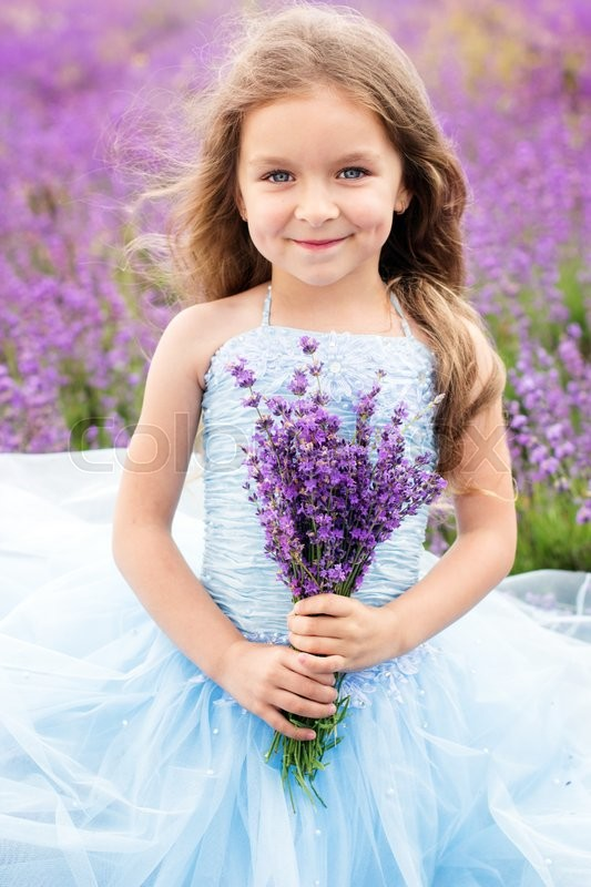 Portrait of cute little girl is in a lavender field ...