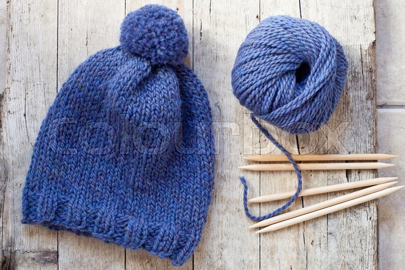Knitting Patterns Wool And Needles : Wool blue hat, knitting needles and yarn on wooden ...