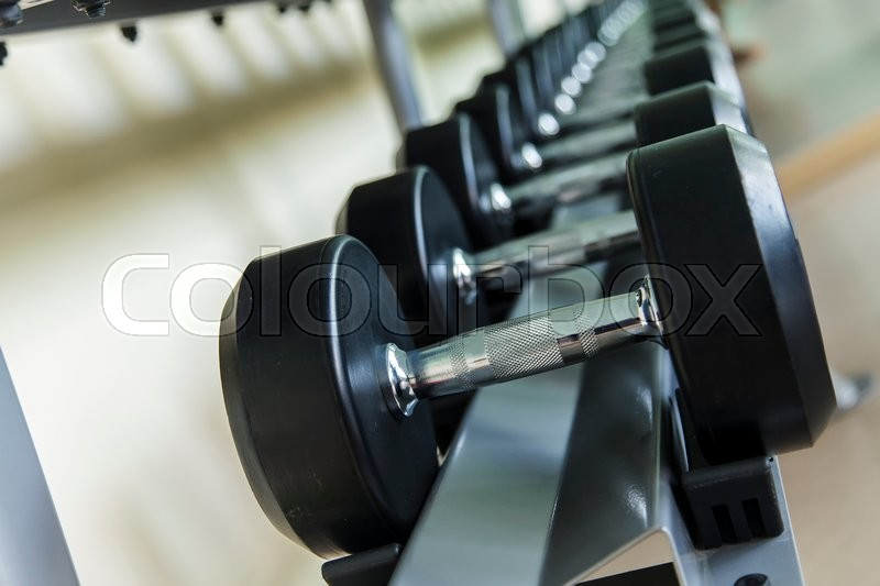 Dumbbells lined up in a fitness studio stock image colourbox