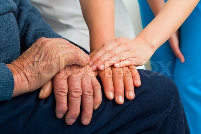 supporting hands for the elderly suffering from dementia stock