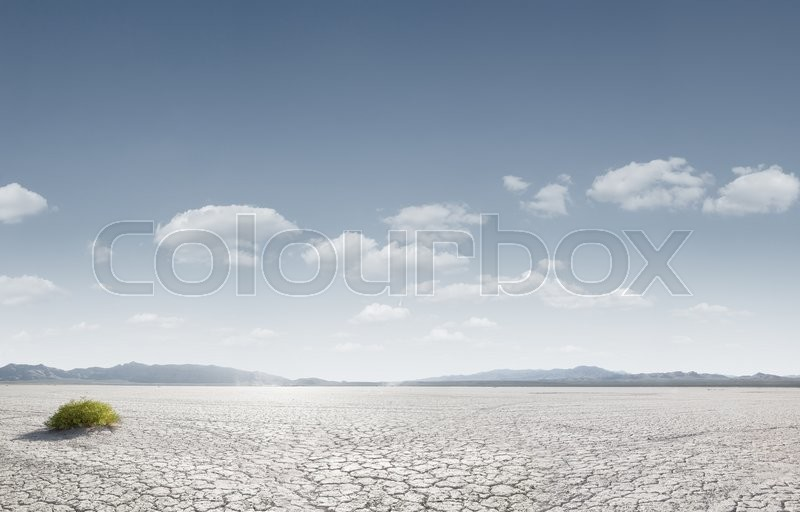 Panoramic view od dry desert in death valley with some mountains on the back, stock photo