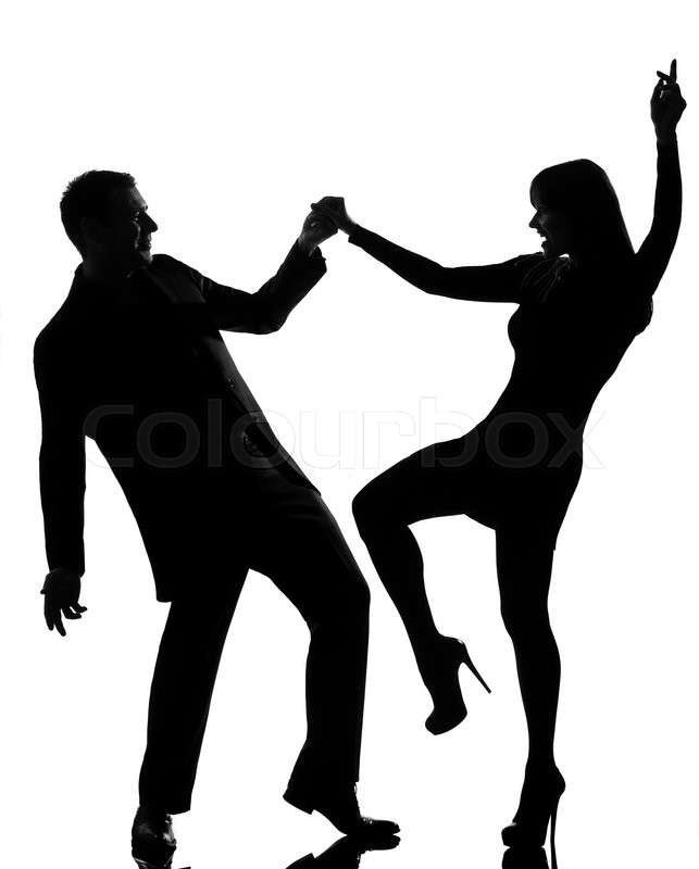 One couple man and woman dancing rock in studio silhouette ...