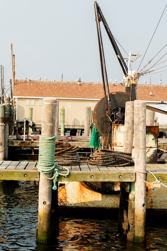 Detail of commercial fishing boat equipment at the dock for Commercial fishing gear