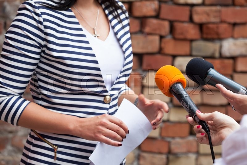Journalist making media interview with woman, stock photo