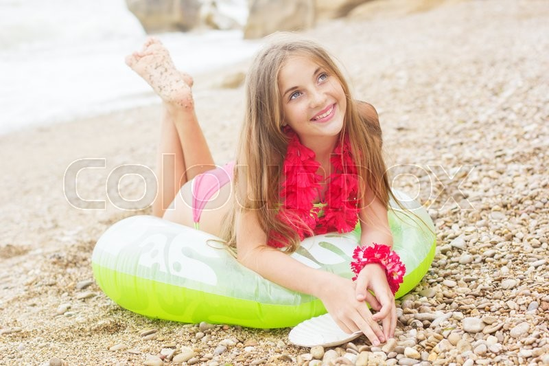 very young teen on beach