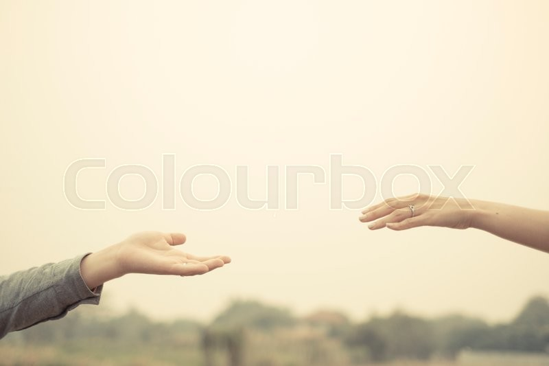 Couple hand together touch with love vintage filter tone, stock photo