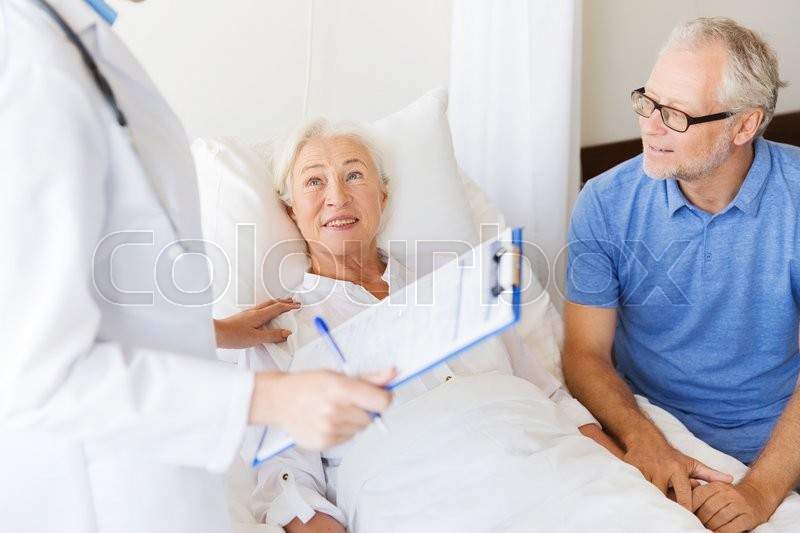 Medicine, age, health care and people concept - senior woman, man and doctor with clipboard at hospital ward, stock photo