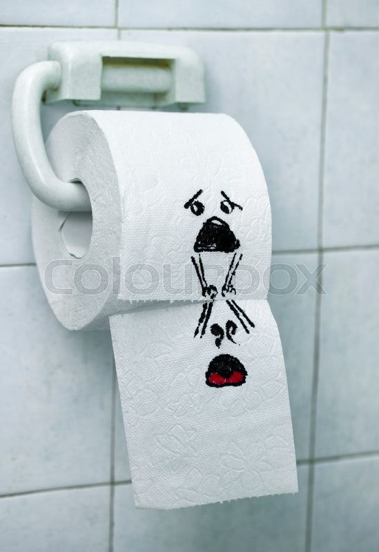 A Roll Of Toilet Paper And Felt Tip Pen Drawn Funny Faces