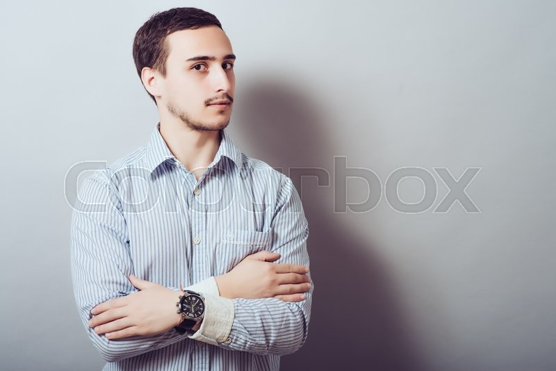 Stock image of 'Casual man with his crossed arms'