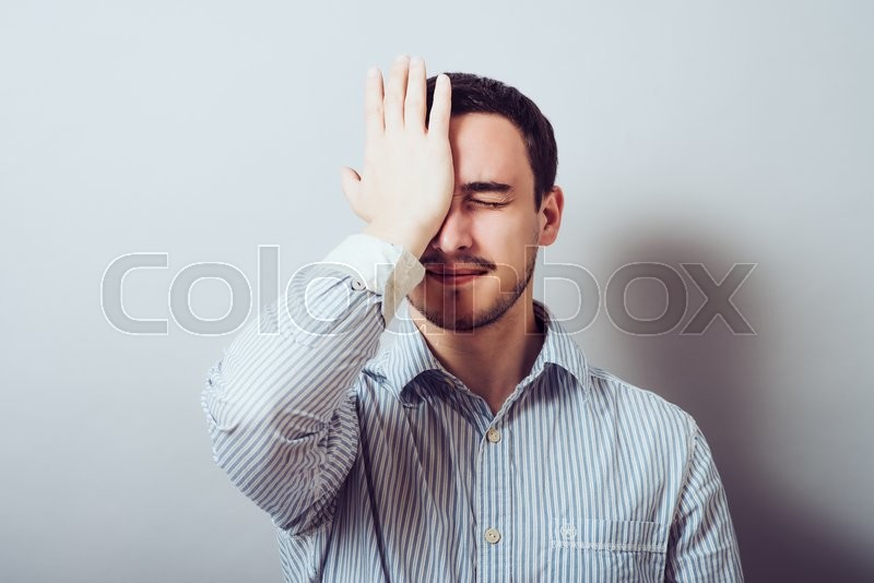 Of young man thinking daydreaming worried deeply about something, uh oh made a mistake. Negative emotion facial expression feeling, stock photo