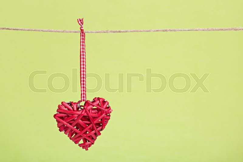 Stock image of 'Lovely red heart with green background'