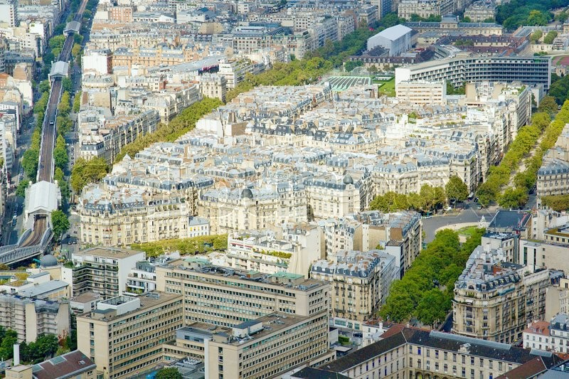 Stock image of 'Photo shows Parisian cityscape taken on the skyscraper with various houses and monuments.'