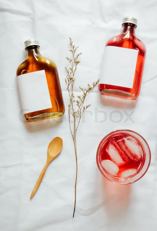 Stock image of 'Cold brew tea branding mockup set with glass of iced tea'