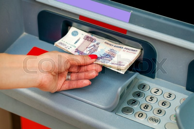Stock image of 'Female hands closeup with Russian rubles - woman withdraw money at cashpoints'