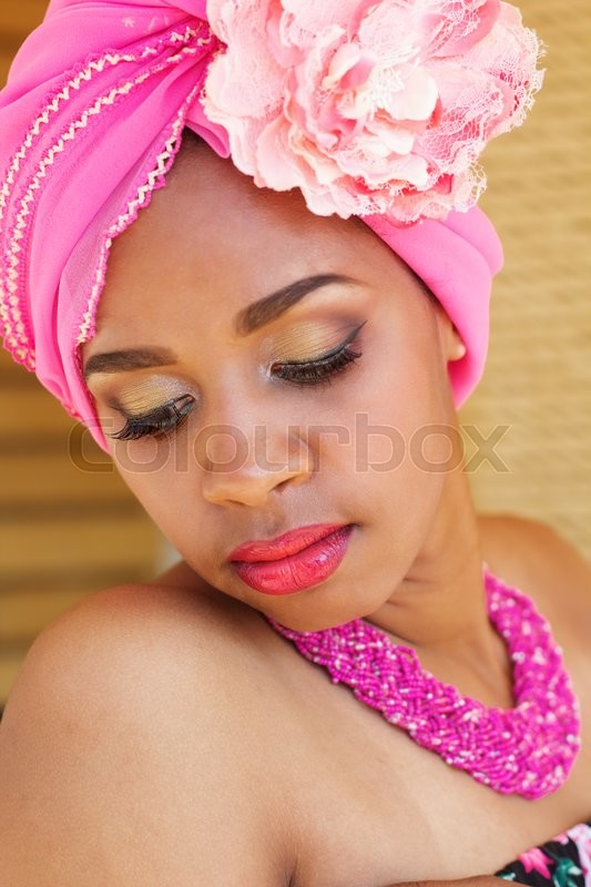 Stock image of 'Young south african zulu woman in traditional clothes portrait outdoors'