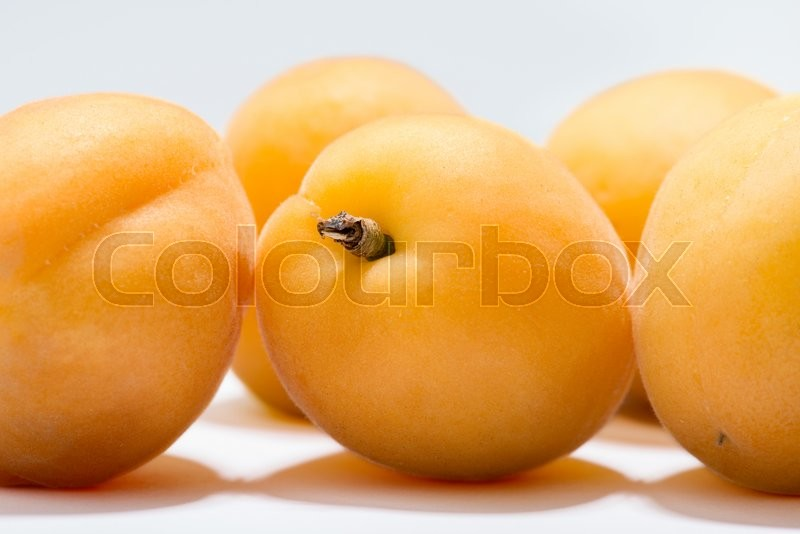 Stock image of 'composition of ripe juicy apricots isolated on white background'