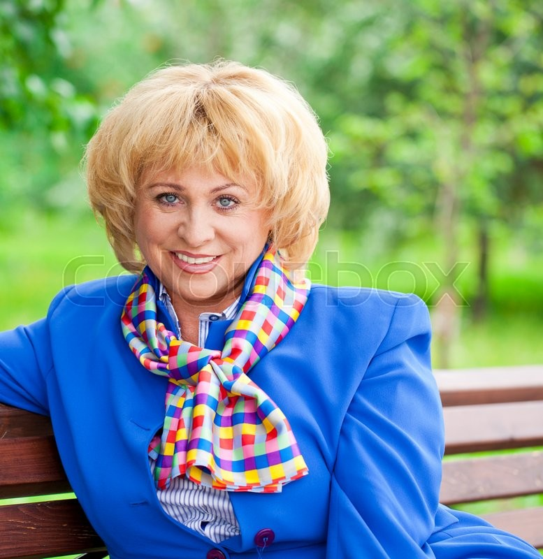 Stock image of 'Close up portrait of a beautiful middle aged woman in a blue business suit'
