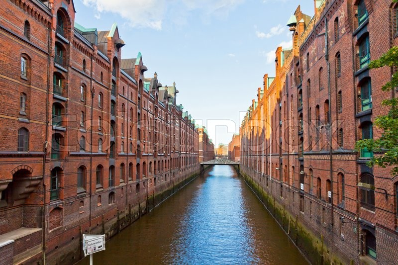 Stock image of 'Famous Speicherstadt district in Hamburg, Germany. This largest warehouse district in the world received the UNESCO world heritage status in July 2015'