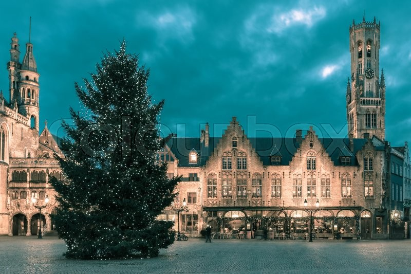 Stock image of 'Scenic cityscape with the picturesque night medieval Christmas Burg Square in Bruges, Belgium. Toning in cool tones'