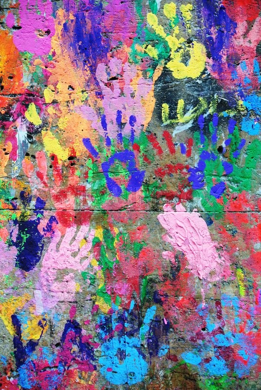 Stock image of 'Photograph of colorful wall with collaborative hand prints'