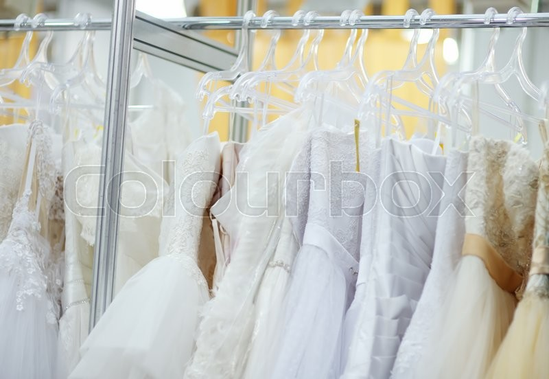 Stock image of 'A few beautiful wedding dresses on a hanger'