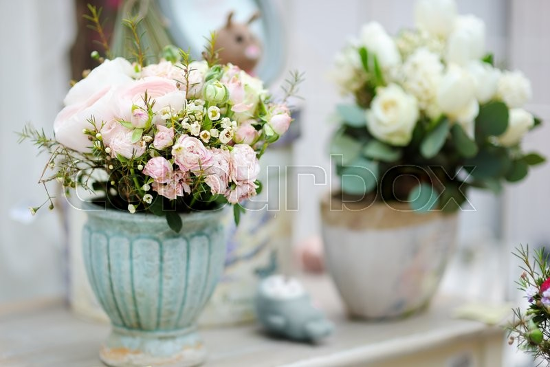 Natural flowers bouquet and decoration objects in the flower shop, stock photo