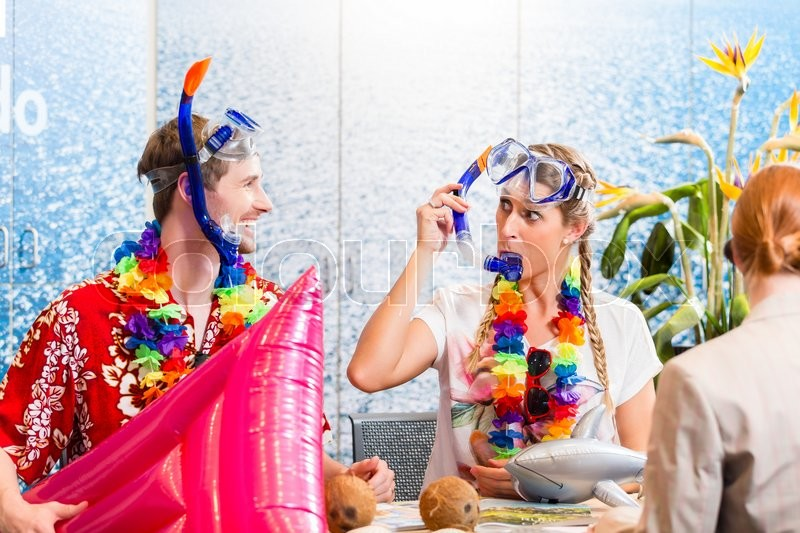 Stock image of 'Man and woman booking beach holiday in travel agency wearing their vacation outfit '