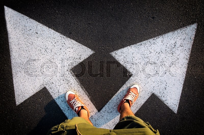 Stock image of 'Red sheoes from above on the white arrows,dilemmas concept'