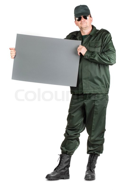 Stock image of 'Man in workwear stands with paper. Isolated on a white background.'