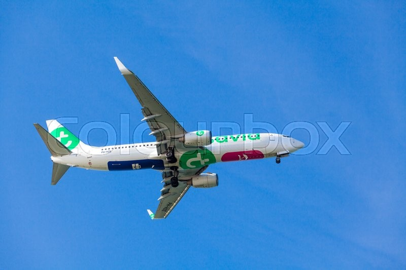 Editorial image of 'FARO,PORTUGAL-MAY 09: A Transavia Boeing 737 approaching to the Faro International Airport, May 09, 2015 in Faro, Portugal.'