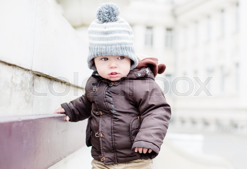 Stock image of 'Toddler portrait kid standing on a bench'