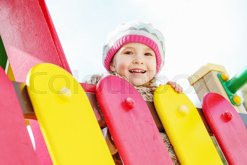 Stock image of 'happy child having fun on the playground'