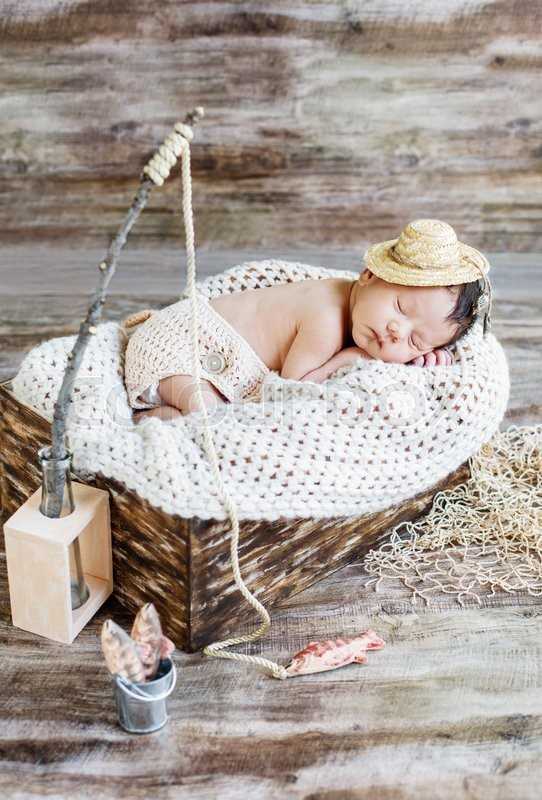 Stock image of 'cute newborn baby boy sleeping in a hat fisherman'