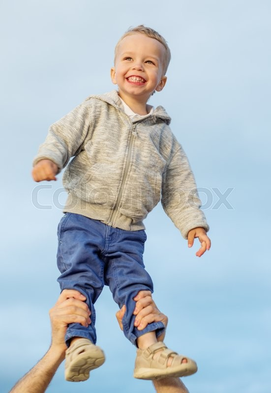 Stock image of 'Happy Toddler boy in his father's arms'